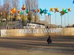 giant pinwheels small child Paris de l'Avenir