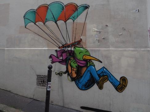 Street art bird man parachute Paris