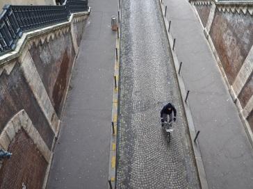 Looking down on a cyclist on rue Pierre Semard from the bridge on rue de Bellefond
