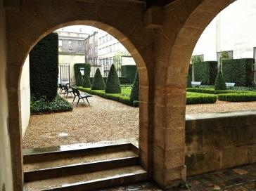 Hôtel Donon Paris garden through arch