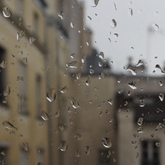 view through raindrops on window