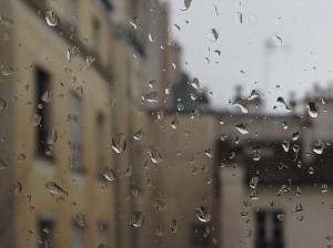view through raindrops on window