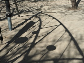 The shadow of a climbing frame makes an abstract pattern - Paris, April 2016