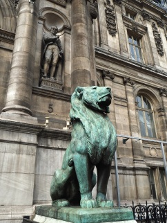 One of the four lions on guard by the east entrances.