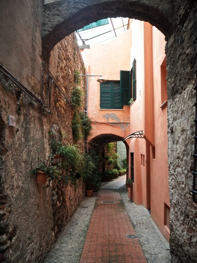 Ventimiglia Alta narrow street with plants