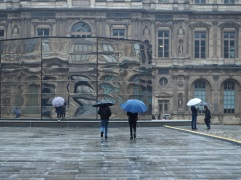 Rain in June and illusions at Le Louvre