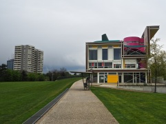 The new Maison du Parc - centre for environmental education and community activities - alongside the grass bridge which links the two parks.