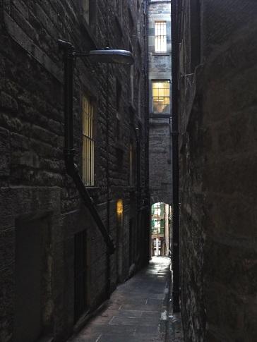 Sunlight barely reaches into this narrow Edinburgh passage.