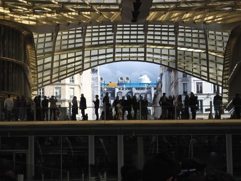 The newly opened canopy at Les Halles frames a view of the Pompidou Centre