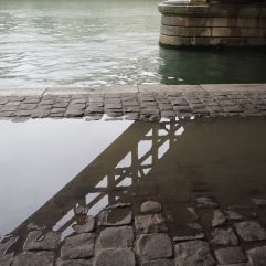 Puddle reflections by the Seine - September 2016