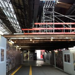 A photographic exhibition under a theatrical scaffolding