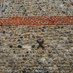 Flint pebbles framed by bands of brick