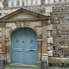 A harder limestone, brought from further afield, frames the door of this grand 17th century house.