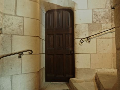Smooth stone curves surround a doorway and staircase in the Chateau d'Amboise