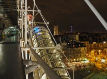 Tiny figures down below in the square give a sense of scale to a nighttime view of the Pompidou Centre