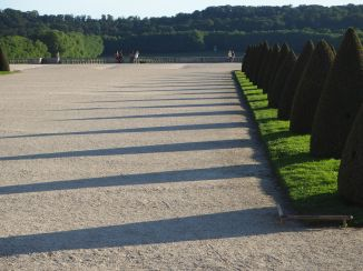 Visitors shrink into insignificance in the vast spaces of the gardens at the Chateau de Versailles