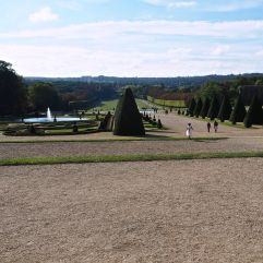 A small bridesmaid, escaped from a tedious photo shoot, lets off steam in the Parc de Sceaux. Tiny figures in the far distance give a sense of the enormous scale of this grand landscape.