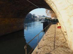 A view through Pont Marie - 'home' for someone sound asleep in a cardboard box.