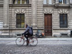 December - a bike by the door in Piacenza.