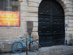 March - a bike by the door in the Marais