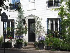 July - flowers round the door in the Cité des Fleurs