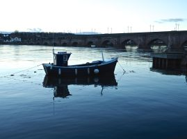 Fishing boat reflections by Berwick Bridge