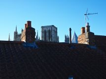 York Minster towers above surrounding houses.