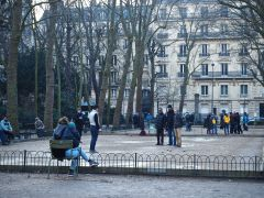Trees shade the petanque courts from summer sun and lend character to this open space in winter.