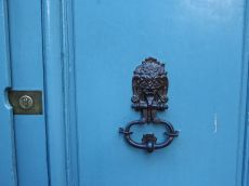 The college moved to this building in 1662. The door knocker doesn't look very welcoming.
