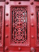 Up close the elaborate ironwork includes an unusual Celtic knot pattern.