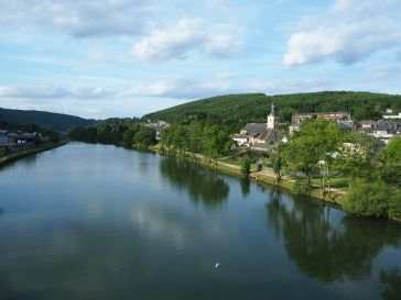 A mid-river view from a bridge over the River Meuse, Ardennes - June 2017