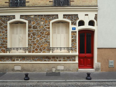 A red door with mouse ears...