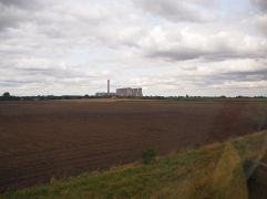 Ferrybridge power station seen across a newly ploughed field