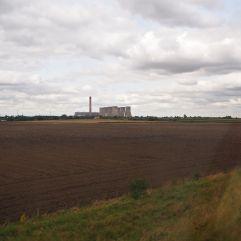 Ferrybridge power station seen across a newly ploughed field