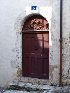 This carving in rue Chemonton looks like a merchant counting his money - an invitation to burglars?