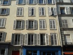 Wooden shutters show that this building predates Haussmann's planning rules - 'Haussmannien' buildings all have metal shutters that fold away neatly into the window recess