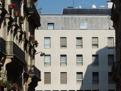 The ornate building in the foreground offers plenty of rails and ledges for window boxes and pot plants. Its modern neighbour is more egalitarian - all the windows are equally featureless