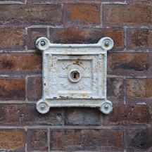 A lock in a brick wall - what opens when you unlock it?