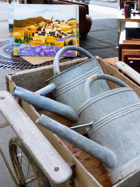 Vintage watering cans in a Paris street market - February 2018