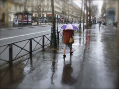 lady with umbrella Boulevard St. Michel Paris