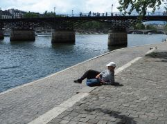 Riverside relaxation - anonymity guaranteed by the hat.