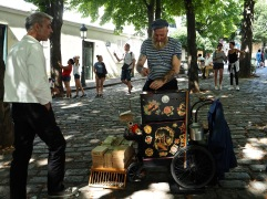 The street organ man catches up with a friend in Montmartre.