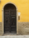Black painted wood - weathered or 'distressed'? - and a pebble door knob