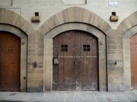 A timeless warehouse door near the river Arno