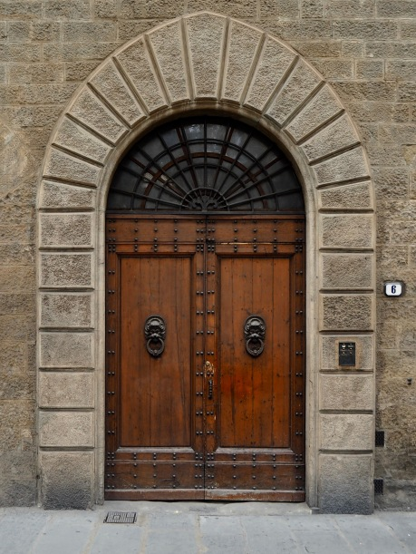 Polished wood, carved stone, an iron fan light and monumental door knockers -there must be hundreds of variations on this theme in the old city