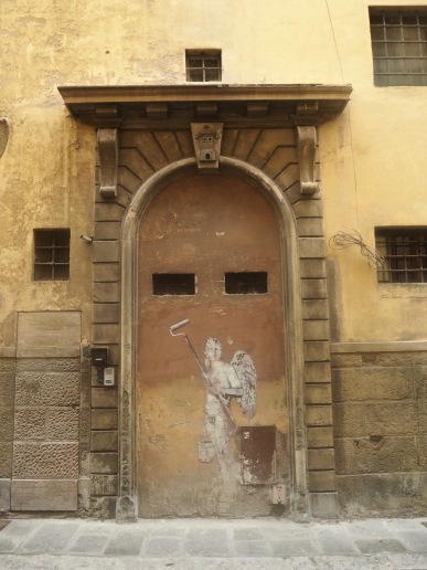 A grand entrance for angels only with a modest door for mortals alongside