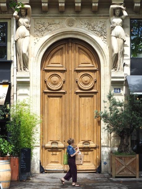 Overlooked by caryatids on Quai de la Mégisserie - June 2017