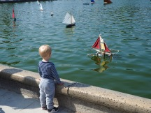 child and model boat Jardin du Luxembourg Paris