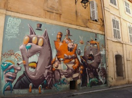 A local guide might read a political message into this mural by Gamo, Difuz and Stom 500 - Les Enfants du Panier