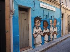 Les Enfants du Panier (dressed in the strip of local team l'Olympique de Marseille) hide an old double door